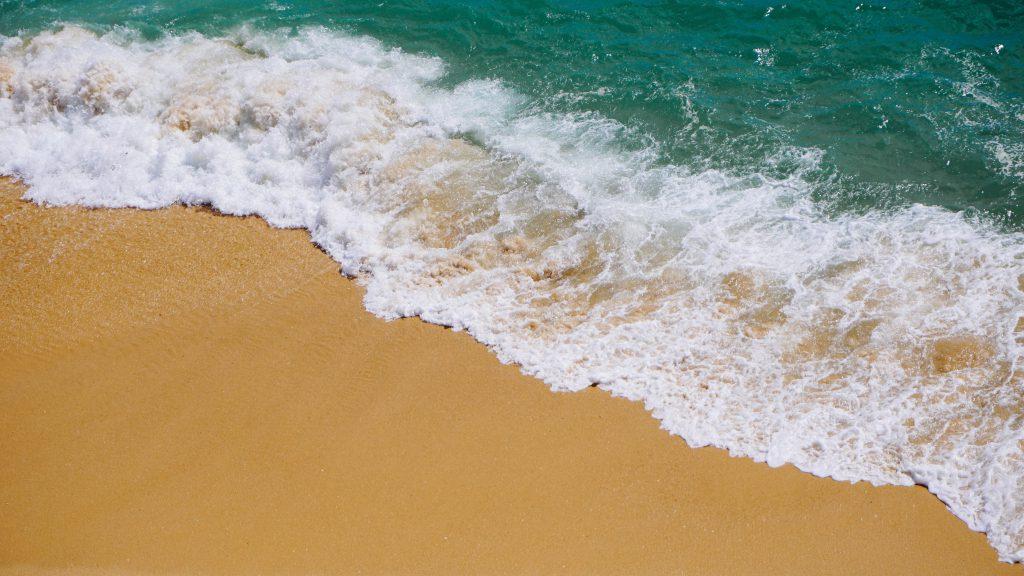 Стоковое фото песка на побережье моря